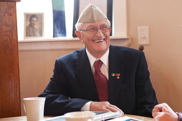 Veteran sitting at table